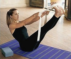 How to use yoga straps in Navasana